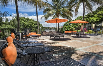 The Atlantic at East Delray patio with seating and umbrellas