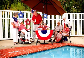 Senior living community in Rainbow City having a picnic outside