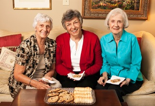 Residents eating cookies at the senior living community in Rainbow City