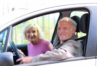 Residents in a car at the senior living in Rainbow City