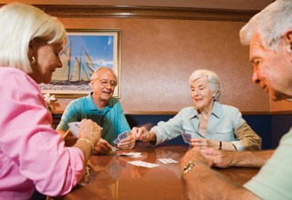 Residents playing cards at the senior living in Rainbow City