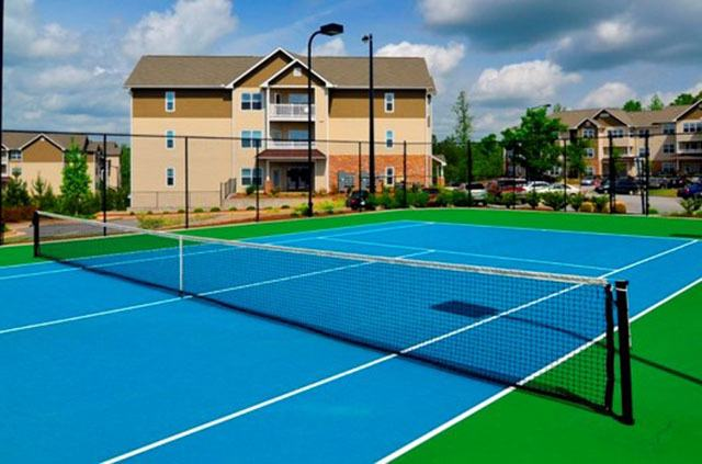Play a game at the tennis courts