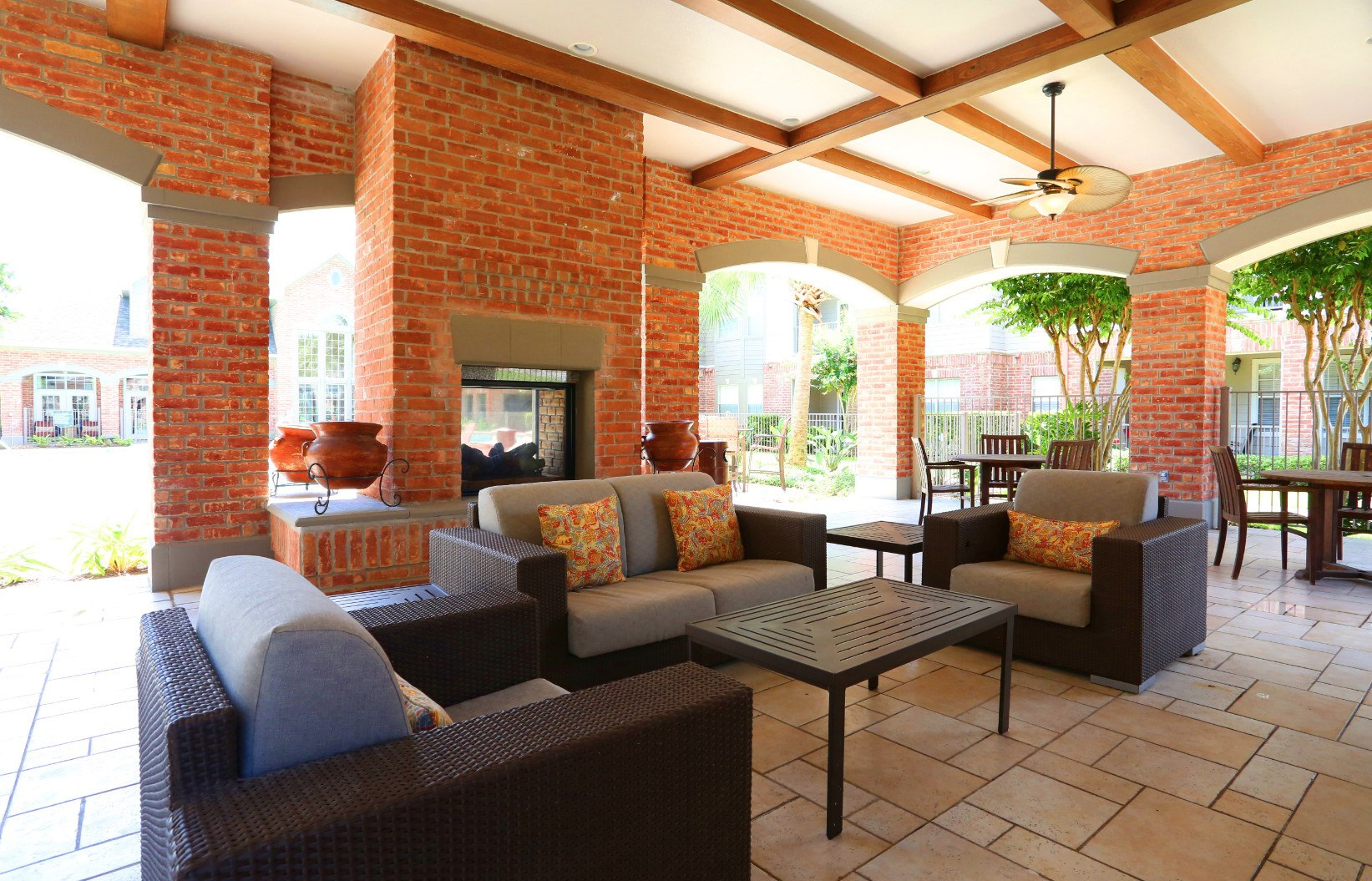 Outdoor brick fireplace at Southwind at Silverlake Apartments in Pearland, TX