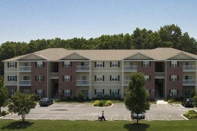 Exterior of apartments for rent at Mill Pond Village Apartments.