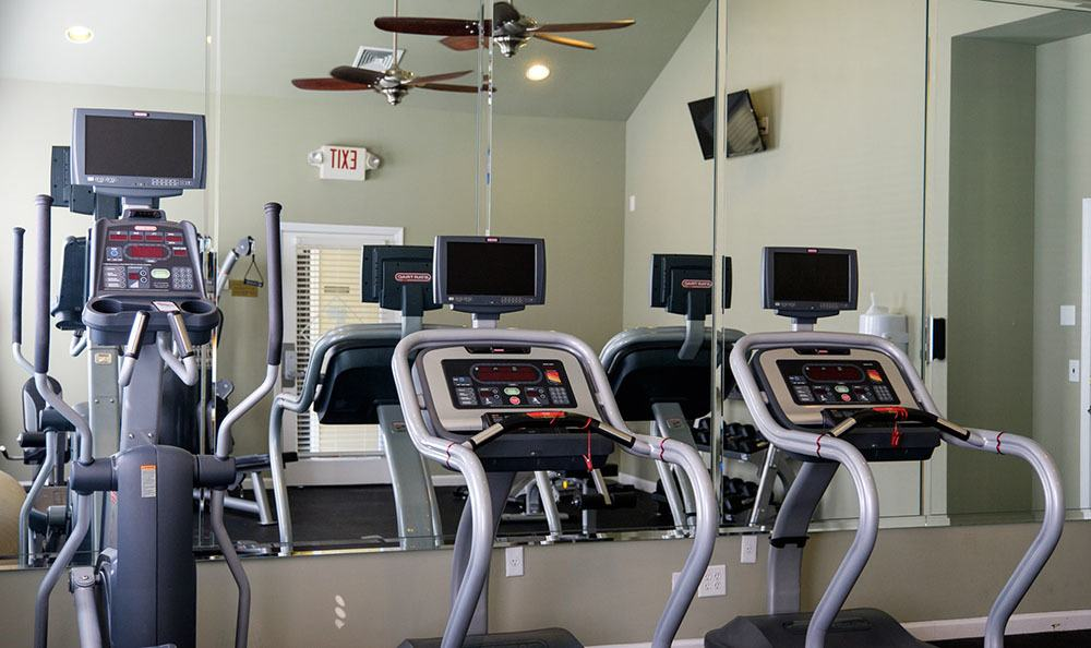 Getting a workout in at our fully equipped fitness center is a great stress reliever at Palmetto Pointe