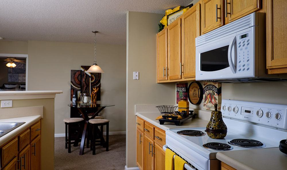 View of the breakfast bar in one of our model units at Palmetto Pointe apartments.