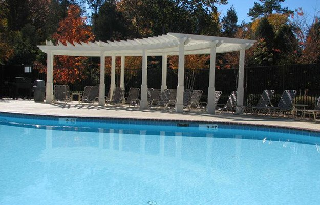 A luxurious swimming pool and sundeck awaits you at Brookstone in Rock Hill in Rock Hill