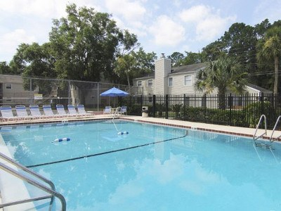 Relax Poolside at Creekwood Apartment Homes in Jacksonville, FL.