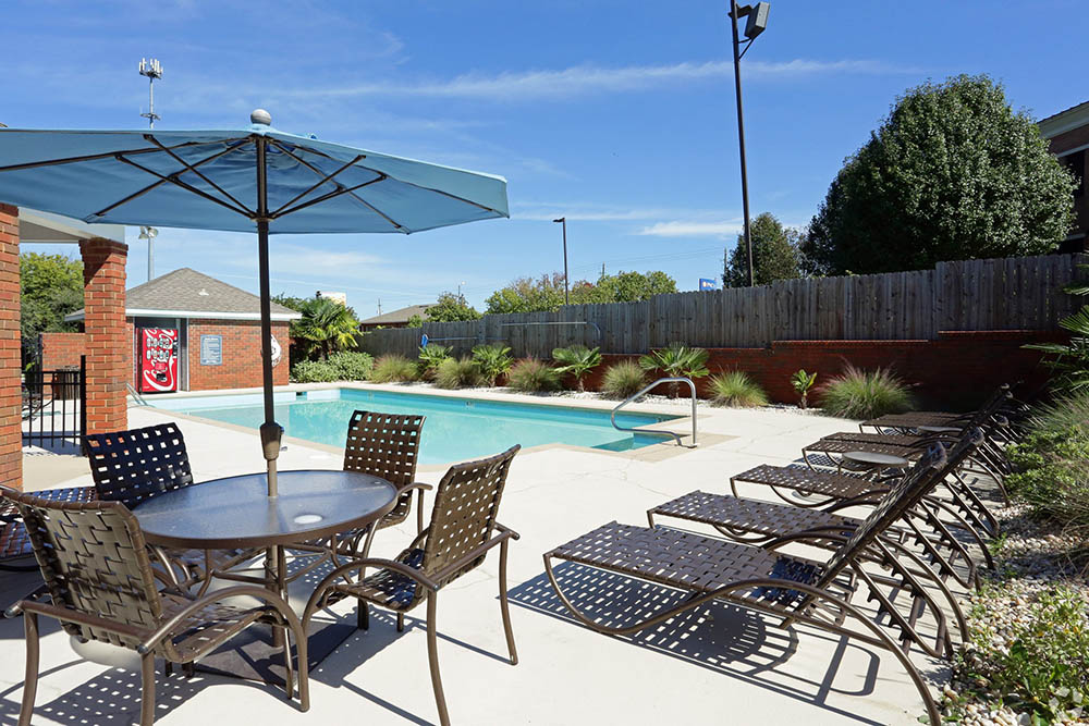 A sparkling pool is just one of the many amenities that Halcyon Park Apartments has to offer