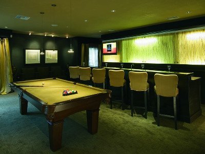 Play billiards at Soleil Apartments with friends