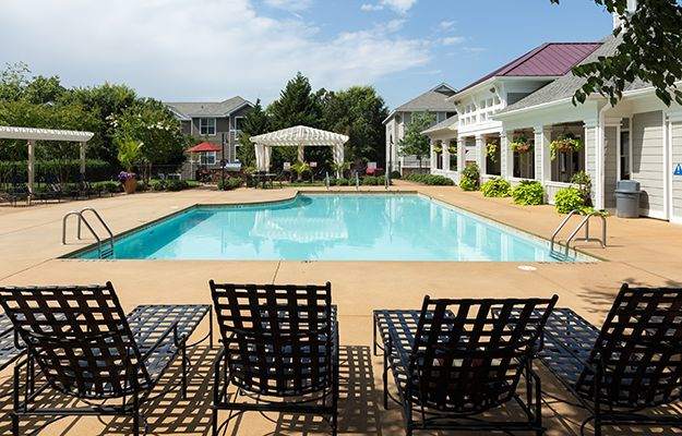 The expansive swimming pool area at The Seasons at Umstead is a beautiful spot to unwind and cool off