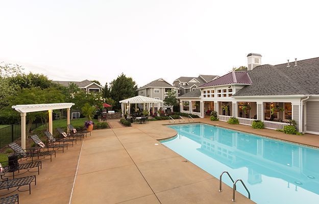 Wide-angle shot of the swimming pool at The Seasons at Umstead in Raleigh on a bright, sunny day