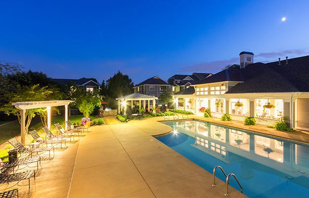 Wide-angle shot of the swimming pool at The Seasons at Umstead on a clear and calm evening.