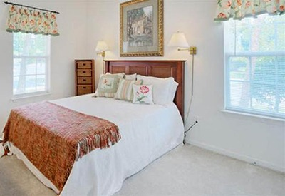 The master bedroom of your new apartment at Highbrook in High Point has plenty of space to feel comfortable and relaxed.