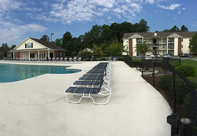 There are plenty of chaise lounge chairs and other places to soak up the sun at our pool area at Northwind Apartments