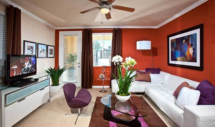Living room with red accents at Avanti Apartments