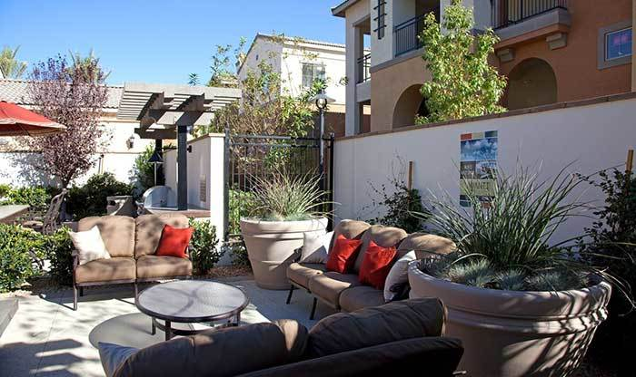 Outdoor living room and BBQ area at Avanti Apartments
