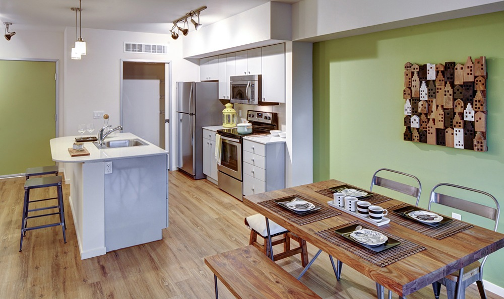 a view of the kitchen and dining area in one of our apartments