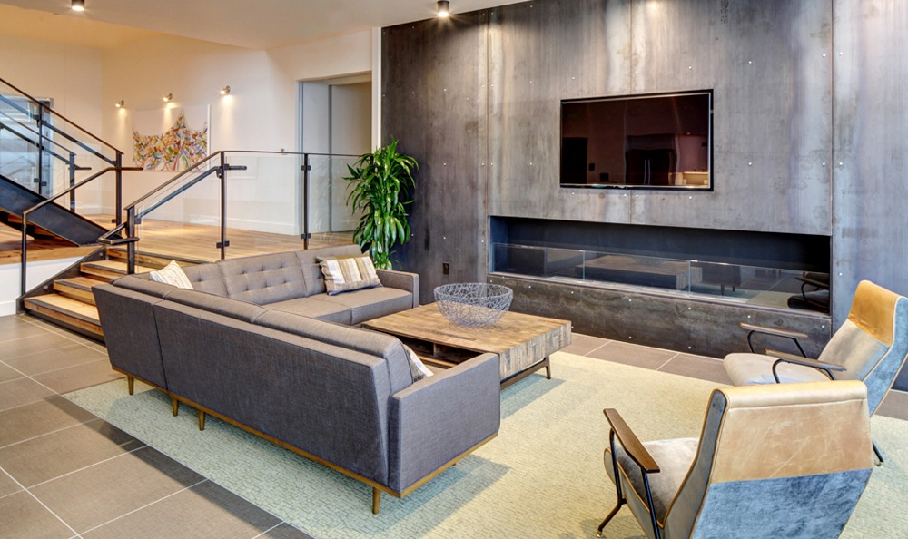our community clubhouse features a fireplace and modern furnishings