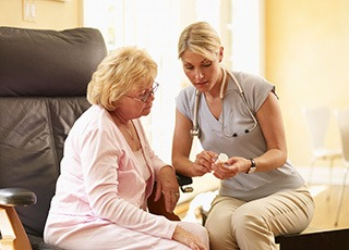 Doctor helping resident with medication at the senior living in Richmond, VA