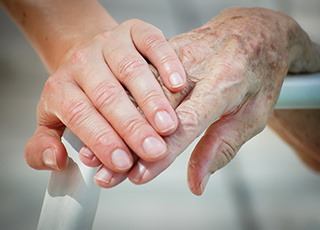 Holding hands in Richmond, VA senior living community