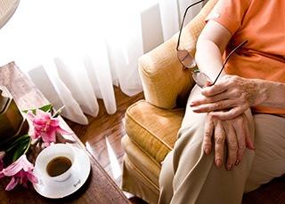Resident enjoying coffee senior living Richmond