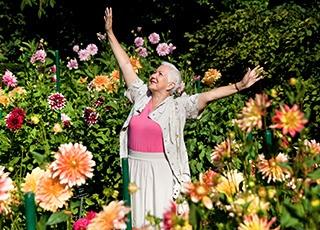 Resident enjoying the flowers at the senior living community in Richmond