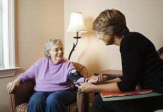 Doctor checking resident blood pressure at the senior living in Bala Cynwyd