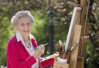 Resident painting at the senior living community in Bala Cynwyd