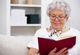 Resident enjoying a book at the senior living in Frederick