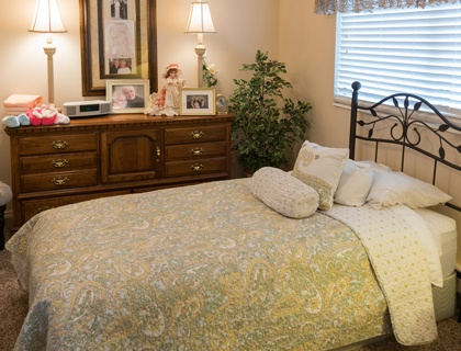 Comfortable bedroom at senior living in St. George.