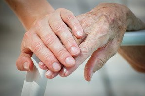 Residents holding hands at the senior living community Marquette