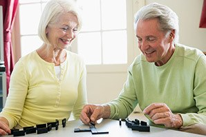 Couple playing games at the senior living in Fayetteville