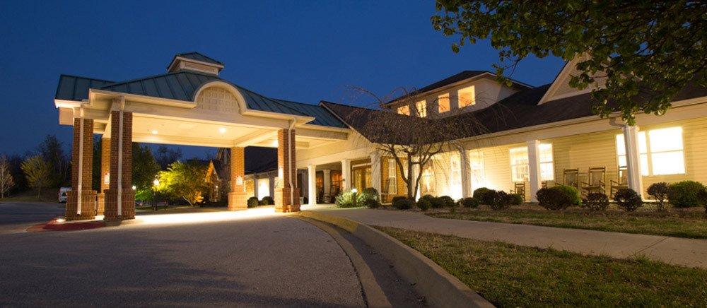 Nighttime exterior of Fayetteville senior living.