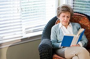 Resident enjoying a book at the senior living in Draper