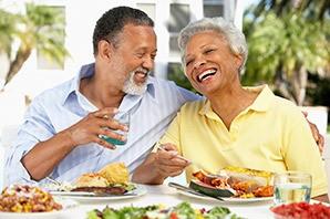 Happy couple enjoying food at the senior living community in Draper