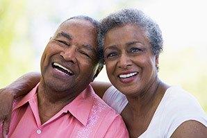 Happy couple enjoying the sunshine at the senior living community in Draper