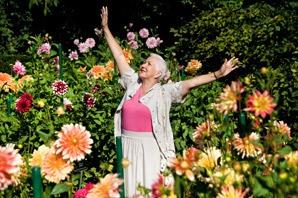 Resident enjoying flowers at the senior living in Draper