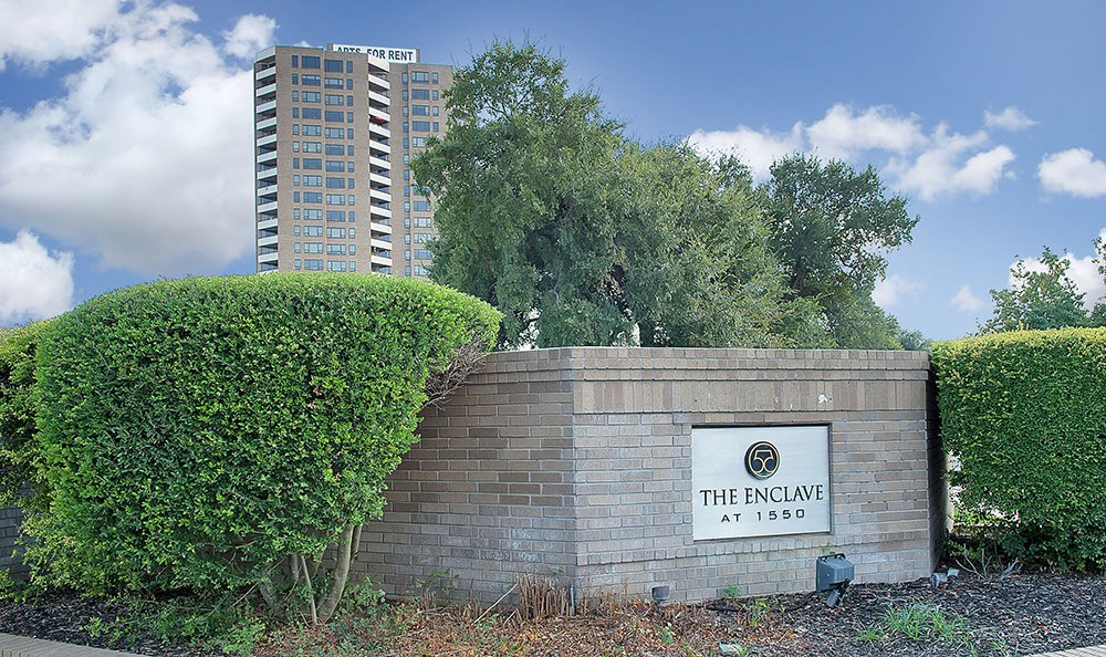 Front sign at The Enclave at 1550 Apartments in San Antonio, TX