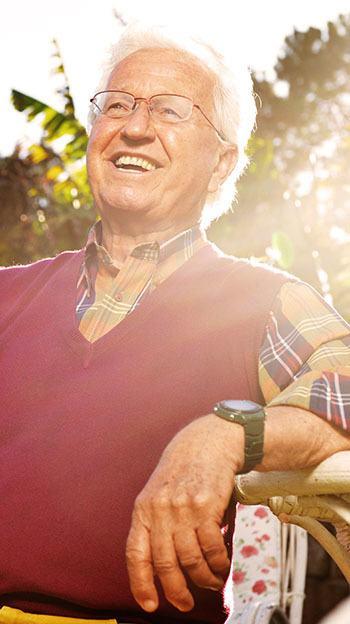 Happy man in assisted living at Farmington Square Beaverton