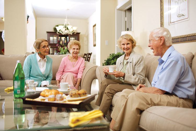 Friends visit together at their senior living apartment in Florida