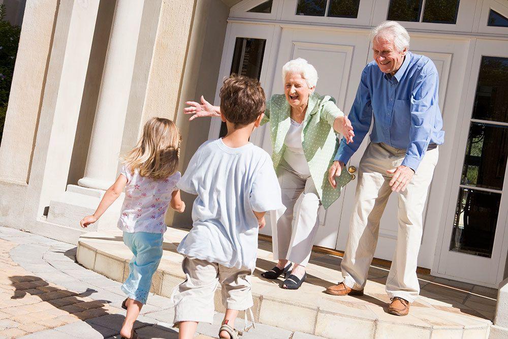 Senior living residents in Palm Beach Gardens visiting their grandchildren