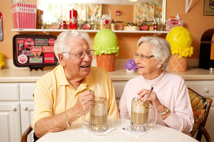 Senior living couple in Suwanee enjoy a milkshake