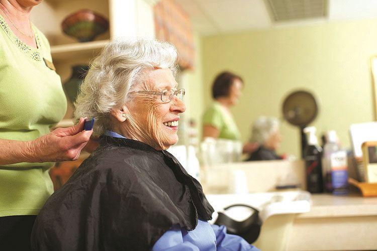 Senior living resident in Suwanee having her hair done at the salon