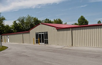 Gray self storage facility shows the exterior building