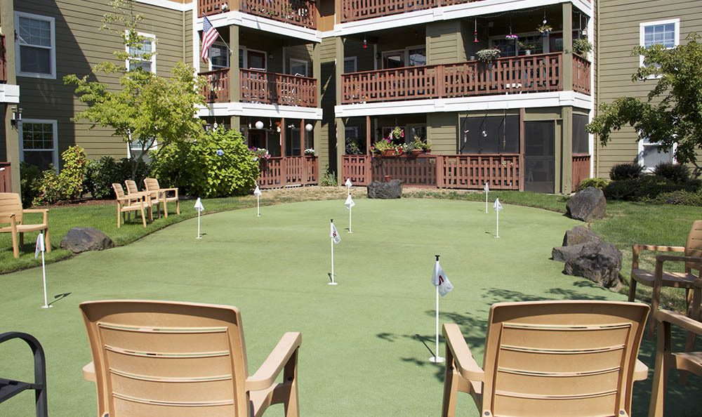 Show off your putting skills at senior living in Milwaukie, OR