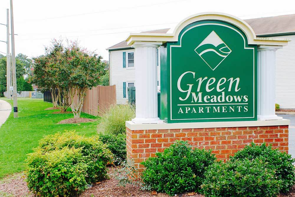 Welcome Sign At Green Meadows Apartments