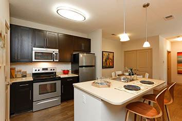 Kitchen with new appliances at apartments in Huntersville