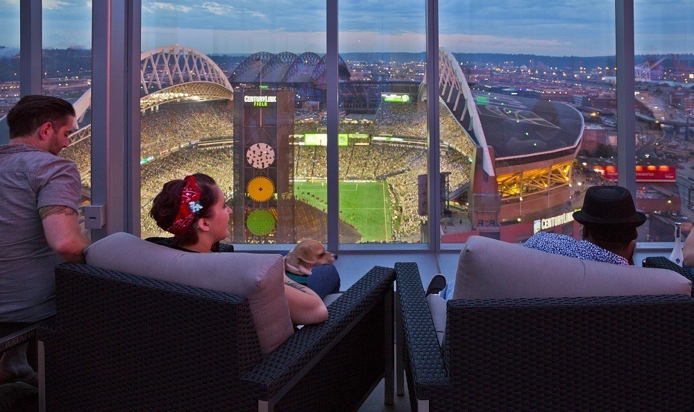 Resident roof top deck with view of Century Link Field at The Wave apartments in Seattle, WA