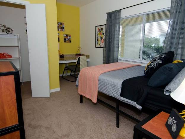 Student apartment bedroom at our Coastal Village Apartments.